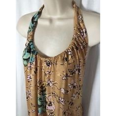 Tropical Floral Halter Top Beautiful Tropical Halter Top   In great condition   Tan - light brown with Turquoise flowers   Tie Top   looks beautiful on especially with a tan  Urban Outfitters Tops Tank Tops