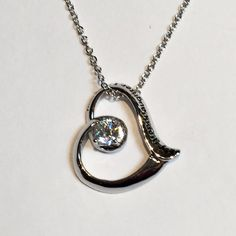 You love your granddaughter and want to tell her in a way that will remind her daily. This beautiful, delicate, floating heart, accented by a sparkling stone tells your granddaughter, Granddaughter, I