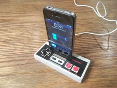 Authentic Nintendo controller iPhone/iPod charger by Tip70Designs. @Jennifer Milsaps Catier ... This is totally you