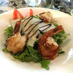 When a crossfit workout collides with Rustico dinner plans you end up with this . A simple arugula salad with shaved parmesan balsamic reduction and topped with tasty grilled shrimp. Fitness & delicious dining mission.....accomplished. #biteofbermuda #bermuda #bermudafood #bermudaeats #wearebermuda #wearebda #lovemybermuda #sharemybermuda #arugula #salad #parmesan #balsamic #grilled #shrimp