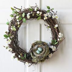 Grapevine wreath with eggs in nest add a burlap ribbon and minus the tiny flowers)