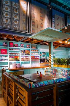 Bright Colors + Wood + built in shelving. Levi Roots Caribbean Smokehouse Interior | B3 Designers