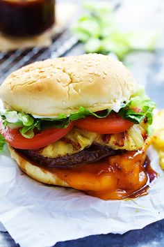 A copycat of the popular Red Robin Bonzai Burger with juicy ground beef, melty sharp cheddar cheese, teriyaki sauce, grilled pineapple, shredded lettuce and more! Gourmet Burgers, Burger Recipes, Copycat Recipes, Beef Recipes, Cooking Recipes, Burger Bar, Burger Night, Burger Food, Burger Toppings