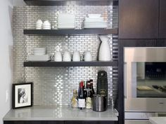 HGTV features an elegant kitchen with espresso bar area with stainless steel backsplash outfitted by the Kitchen Cousins. Espresso Bar, Kitchen Shelves, Kitchen Backsplash, Backsplash Ideas, Kitchen Cousins, Deco Paris, Stainless Backsplash, Deco Design, Interior Exterior