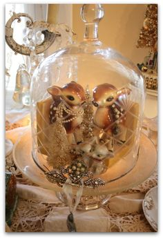 Karla's Cottage:  A glittery woodland holiday--ceramic deer draped with beads under glass