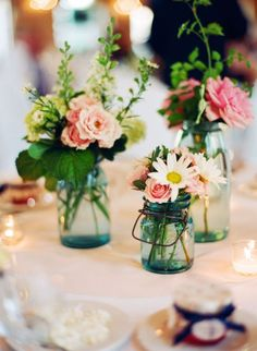 flowers in blue mason jars
