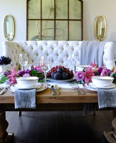 dinner party set with arte italica pieces and beautiful floral garland centerpiece in elegant dining room