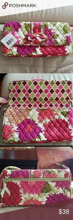 """Vera Bradley """"Knot Just a Clutch"""" Shoulder Bag NWT shoulder bag that can be used as a clutch as well. Strap is detachable. Pattern is Hello Dahlia and has very vibrant colors. Stored in a smoke and pet free home! Measures approximately 12x6. Vera Bradley Bags Shoulder Bags"""