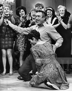 Anthony Quinn and Irene Papas join in a traditional joyful Greek dance in a scene from the film 'A Dream of Kings', 1969.