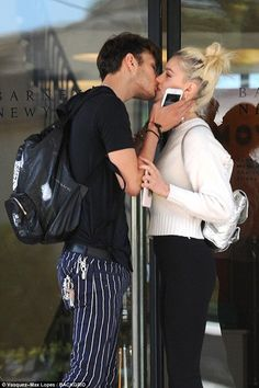 Young love: Anwar Hadid, 17, awkwardly kissed girlfriend Nicola Peltz, 22, as they left Barneys in Los Angeles on Thursday