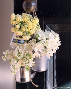 all those old paint cans that get thrown away, could be some cute aisle decorations with flowers!!