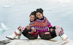 Two young Greenlandic women in national costumes
