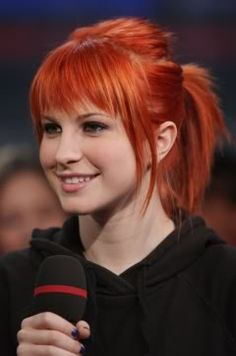 I might try to cut my bangs like this over the weekend. the color is gorgeous too....