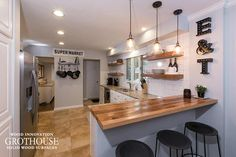 Distressed wood countertops reclaimed wood kitchen bar tops for seating in modern farmhouse style kitchens distressed Kitchen Bar, Wood Kitchen Backsplash, Wood Kitchen, Reclaimed Wood Kitchen, Wood Countertops, Farmhouse Style Kitchen, Contemporary Kitchen Backsplash, Oak Kitchen, Wood Bar Top