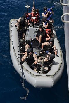 The visit board search and seizure team of USS Ross (DDG 71) conducts a boarding demonstration aboard USS Ross.