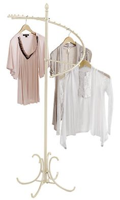 Boutique Ivory Spiral Clothing Rack | $63 at Store Supply Warehouse