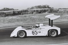 Phil Hill driving the #65 Chaparral 2E in 1966. Later in the season, the end plates were removed from the rear wing. Speculation was that this was to reduce rear down force, to better balance the car in high speed corners. With the end plates gone, spanwise flow would reduce the wing's efficiency, and reduce high speed understeer.