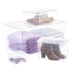 Container Store Clear Storage Boxes $1.69 - $21.99.  They are almost straight-sided, just a bit tapered, clear w/ hidden latches.