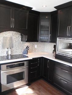 black kitchen with white counter tops