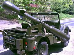 M38A1-D armed with a Davy Crockett Nuclear Rifle    The Davy Crockett tactical nuclear cannon (Recoil-less Rifle). It saw only brief service with the U.S. military in the early 1960's, before somebody thought having Jeeps carrying nuclear weapons may not be the ideal solution.
