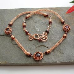 """Garnet and copper necklace. Three round Garnet cabochons are set in my Scalloped edge bezel design and are connected together with Garnet links with handmade Viking knit chain and finished with a handmade hook clasp. The necklace is 16"""" long"""