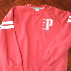 PINK Victoria Secret crew sweatshirt PINK VS crew sweatshirt worn once and washed once. Coral in color. It has side seam pockets. Super soft and comfy fit PINK Victoria's Secret Tops Sweatshirts & Hoodies