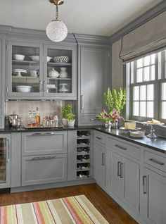 """A first-class butler's pantry boasts """"leatherized"""" black-granite counterto. A first-class butler's pantry boasts """"leatherized"""" black-granite countertops, silvery grasscloth wallpaper, and a sparkling ceiling fixture. Wallpaper by Phillip Jeffries Kitchen Cabinet Design, Kitchen Redo, Kitchen Interior, New Kitchen, Kitchen Paint, Corner Kitchen Cabinets, Maple Kitchen, Ranch Kitchen, Condo Kitchen"""