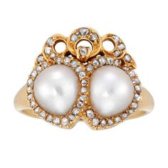 A late Victorian pearl and diamond twin heart ring, the ring comprising two interlocking hearts, each set to the centre with a natural pearl to a rose-cut diamond-set border, with diamond-set bow surmount, all grain-set to a yellow gold mount and tapered D-section shank, gross weight 7.5 grams, circa 1880