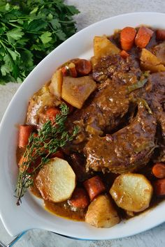 The best Pot Roast you'll ever try! No extra frills, just well seasoned, fork tender beef Pot Roast with all of the trimmings!