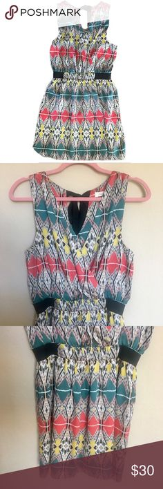 """SUGARLIPS Multicolor Tribal Dress Size: 6 **NOTE: Separation between material and elastic black band. (Picture at the end). Easy fix or easy hide (can't tell while wearing it).  Gorgeous dress perfect for summer. Has a lovely tribal pattern. Ties in back of neck. Built in slit so dress is NOT see-thru.  Size: 6 Materials: Self: 100% polyester; Contrast 97% polyester 3% spandex; Lining 97% polyester 3% spandex *Measurements: Armpit to armpit: 18"""" laying flat (elastic underarm) Waist: 27""""…"""