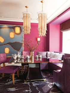 Invigorating bright pink walls, purple upholstered chairs and colorful contemporary art enliven this eclectic dining room. And what about those two stunning chandeliers? Image: Digs Digs room design pink How to Decorate with Bold, Bright Beautiful Color Interior Exterior, Home Interior, Interior Decorating, Decorating Tips, Yellow Interior, Studio Interior, Decorating Websites, Interior Walls, Kitchen Interior