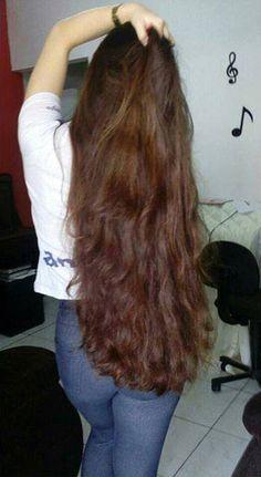 Shiny wavy classic length brunette.