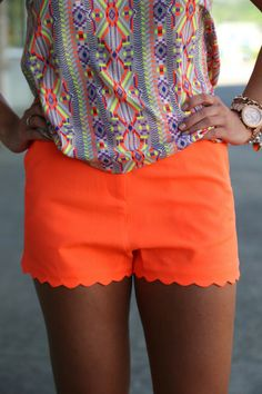 Great example of pairing neon with prints. We think scalloped shorts rock! -Closets Full of Sunshine