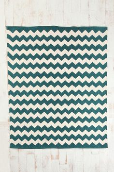 For under dining room table? Not sure if 5x7 would be large enough.....UrbanOutfitters Zigzag Rug