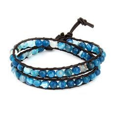 Rich tones of entrancing blue make up our Chen Rai Shades of Blue Agate Double Row Wrap Bracelet, part of our expanding collection of stylish wrap bracelets. On this eye-catching style, sky blue, turquoise, navy, and sapphire colored beads are bound together by dark brown leather. This bracelet wraps twice around the wrist and is ideal to be worn alone or stacked with other colorful wrap styles.