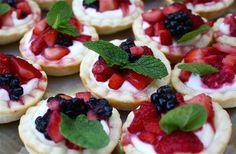 Cream cheese & berry tart using sugar cookies as the pastry. Yum yum!