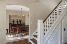 best paint colour for home staging and selling is manchester tan by benjamin moore which is neutral with very little undertone. Shown in stairwell and dining room