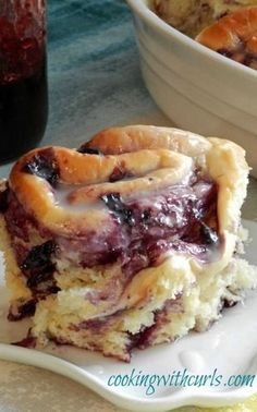 These fluffy and delicious Blueberry Sweet Rolls are made with homemade blueberry preserves and topped with lemon glaze!