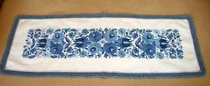 Small, blue hand-embroidered Matyo tablecloth with hand crocheted blue borders