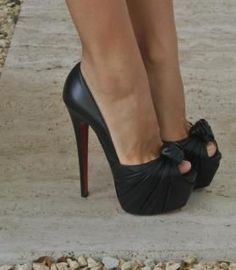 black bows are cute, heel height is killer. Too bad my husband is the same height as me...