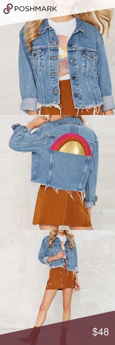 Denim Rainbow Jacket NWT boutique item. This light blue denim jacket features a frayed hem, FAUX side pockets, a button down silhouette, buttons at the wrist, two pockets at the chest, and finally an amazing vegan leather rainbow design on the back.. Perfect with high-waisted ripped denim, a band tee, and some open toe booties!Material: 97 % Cotton, 3% Man Made Materials. Color(s): Blue (looks lighter then in modeled image). Label: Haoduoyi. Handwash. Imported Jackets & Coats Jean Jackets