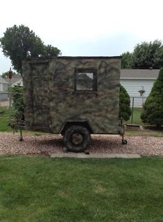 My neighbor, Jerome Porter, made this mobile hunting blind. His wife, Janet, painted it camoflaged with spraypaint. Inside it is carpeted, with real windows, a heater, and various other amenities.