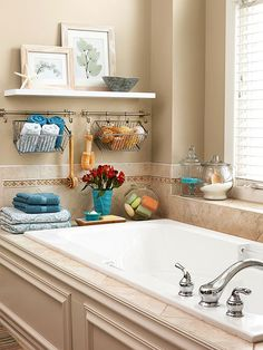 The windowsill and tub deck here offer narrow spaces for practical items, while slim wall stretches are great for hanging rods with baskets and shelves.