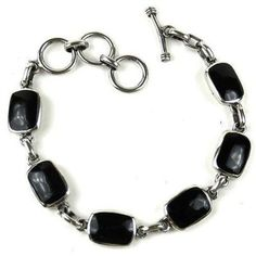 Handcrafted Mexican Alpaca Silver and Onyx Bracelet Handmade and Fair Trade. Handcrafted by women in a cooperative in Mexico, this link bracelet features six onyx pieces inlaid in hand cast alpaca silver. Silver jewelry website shop store | Simple stones design ideas | Beautiful shape accessories for hipster | Inspiration style jewellery | USA charms | Awesome tribe tribal mom | Sweet fashion jewelry for mom mother her girlfriends |  GIFT IDEAS