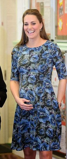 Catherine, Duchess of Cambridge blossoming bump in a floral frock from Seraphine as she visits Cape Hill Children's Centre on 18.02.2015 in Smethwick, England