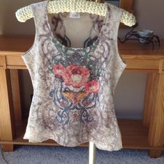 Top Sleeveless Multi color. Beautiful tank top flower design.size medium.     Same design on the reverse side and lace over fabric 180 Tops Tank Tops