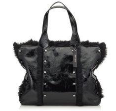 A versatile, modern, everyday bag, the Lockett Shopper tote in black shiny naplack and shearling is a modern companion. Flawlessly crafted from drum dyed and painted calf leather panels, this stylish tote is assembled with stud details creating a durable yet luxurious finish. Endlessly versatile, wear yours on the shoulder, on the arm or carried in hand. The perfect city bag for the contemporary girl.