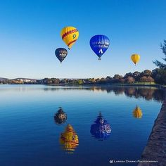 """""""Good morning! It's another beautiful day in Canberra. The hot air balloons were out this morning drifting over Lake Burley Griffin."""" Photo taken by Instagrammer @larissadening on a recent visit to the capital. #visitcanberra"""