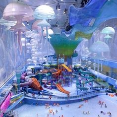 """Water Cube Water Park - Beijing - known for its innovative design and """"bubble wrap"""" skin—is home to the largest indoor water park in Asia, featuring slides, wave pools, a lazy river, and other amusements."""