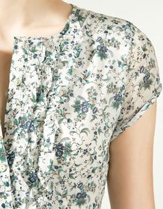 I love the print and the ruffles.